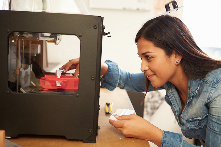 Female Architect Using 3D Printer In Office